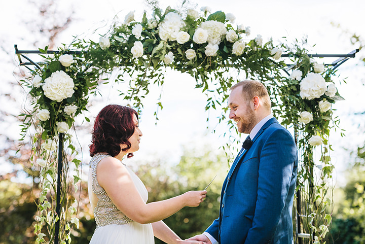Louise and Sam's Gold and White Outdoors Wedding with an Evening Pool Party vows