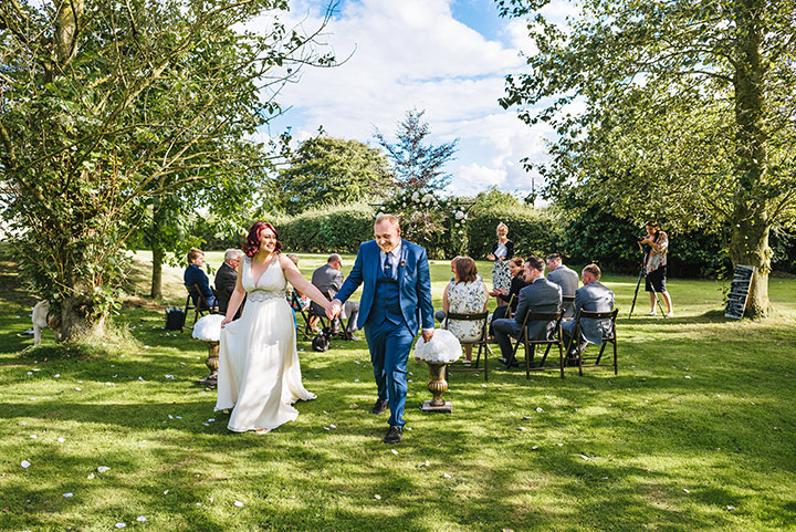 Louise and Sam's Gold and White Outdoors Wedding with an Evening Pool Party bride and groom