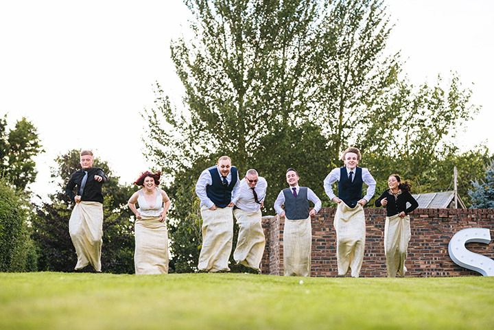 Louise and Sam's Gold and White Outdoors Wedding with an Evening Pool Party sack races