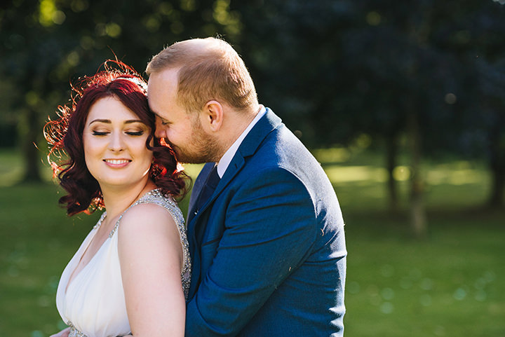 Louise and Sam's Gold and White Outdoors Wedding with an Evening Pool Party kissing couple