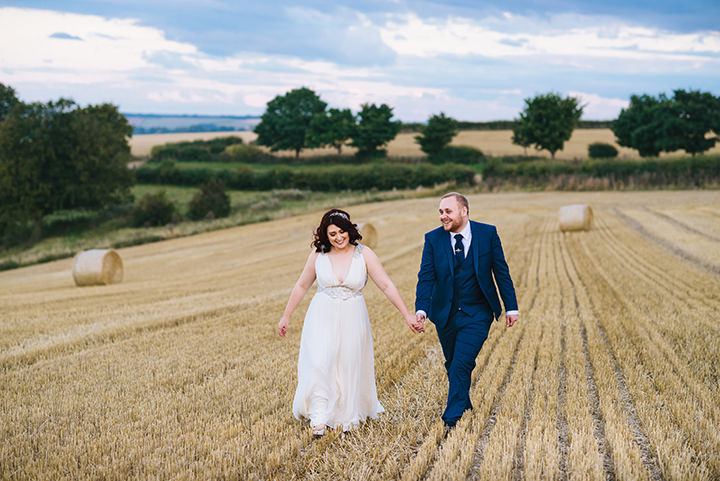 Louise and Sam's Gold and White Outdoors Wedding with an Evening Pool Party couple in the field