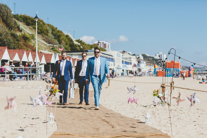 Bournemouth Beach Groom walking to Wedding By Paul Underhill Photography