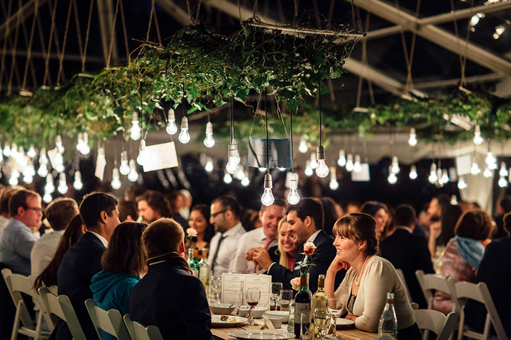 Wedding at Kilminorth Cottages hanging lights in Looe By Freckle Photography