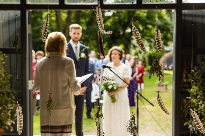 Outdoors In Anglesey Wedding feathers By Gill Jones Photography