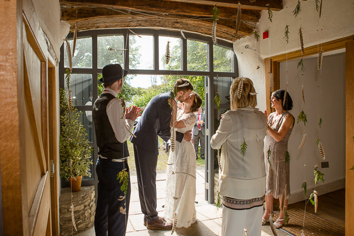 Outdoors In Anglesey Wedding first kiss By Gill Jones Photography