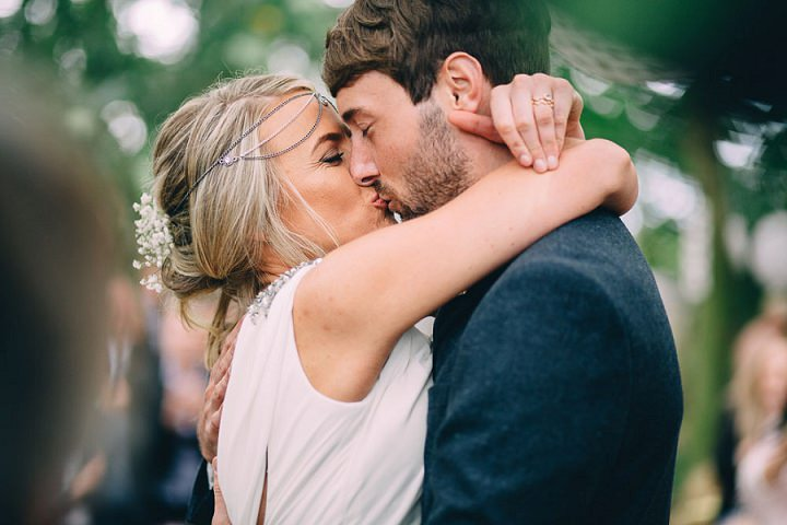 Festival Wedding first kiss at Stanley Villa Farm in Preston By Mike Plunkett Photography