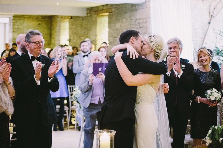 New Years Eve Wedding at The Great Tythe Barn kissing By Kevin Belson Photography
