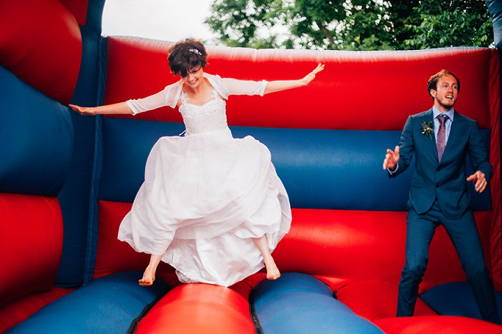 Back Garden Welsh Wedding bouncy castle By Kelly J Photography
