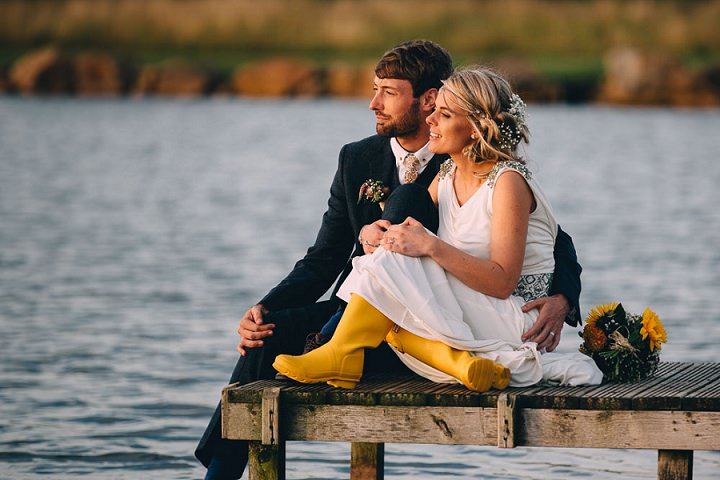 Festival Wedding at Stanley Villa Farm bride wearing yellow wellies in Preston By Mike Plunkett Photography