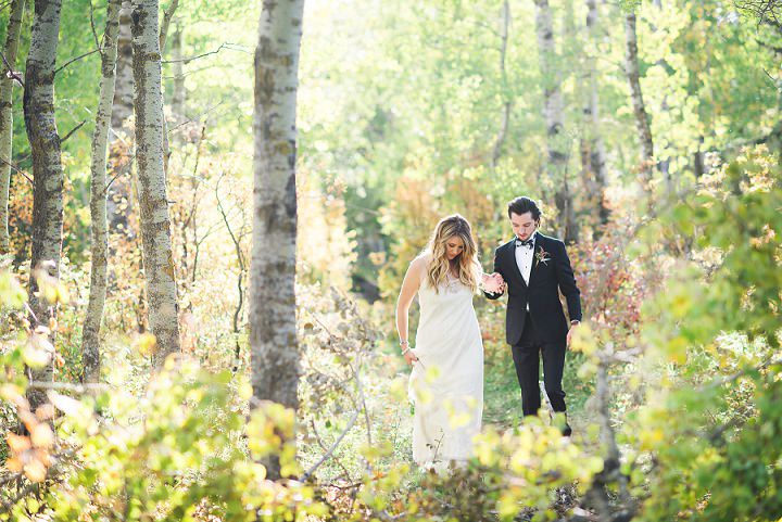 Canadian Camp Wedding bride and groom in the woods By Kristyn Harder Photography