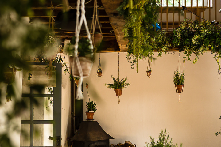 Outdoors In Anglesey Wedding with hanging plants By Gill Jones Photography