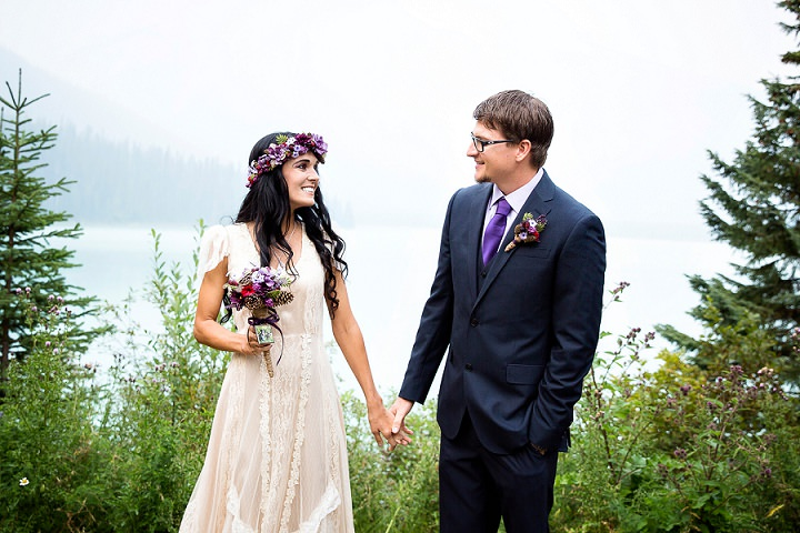 Beautiful Mountain Elopement bride wearing flower crown By Kim Payant Photography