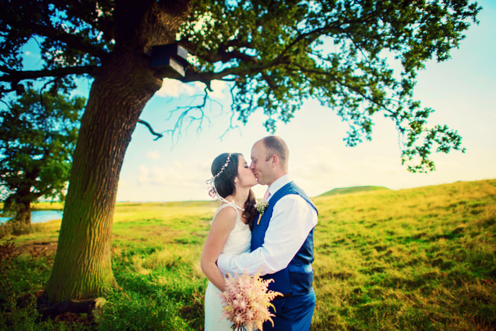 Homespun Barn Wedding bride and groom at Elmley Nature Reserve in Kent By Photography By Vicki