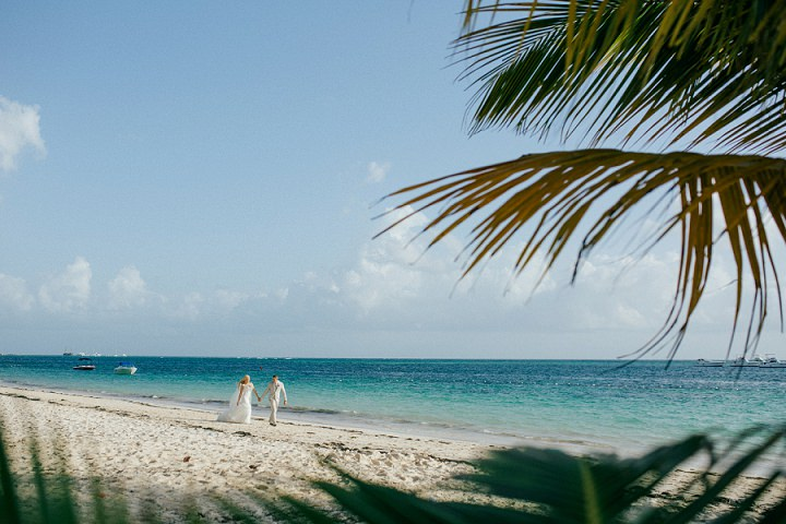 Beach wedding in the Dominican Republic By Asia Pimentel Photography bride and groom on beach