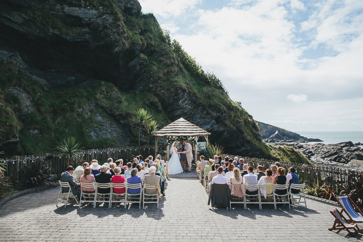 Wedding ceremony By Helen Lisk Photography at the fabulous Tunnels Beaches