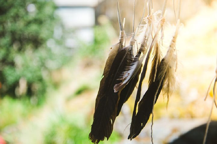 Bohemain Backyard Wedding feathers By K Good Photo