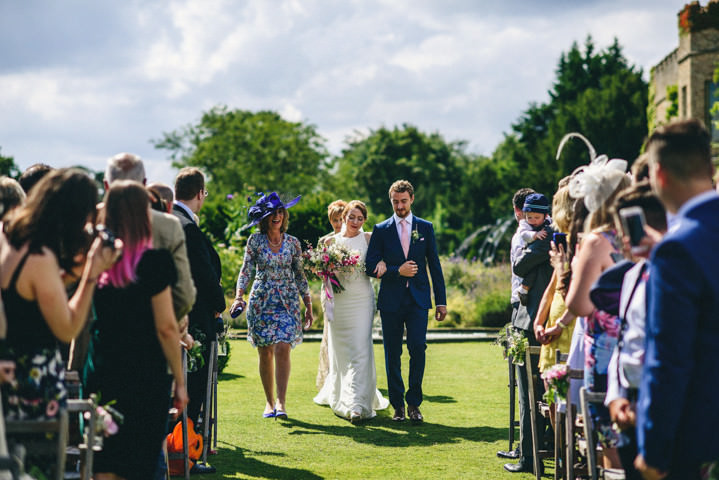 Outdoor English Country Garden Wedding in Norfolk by Miki Photography with an outoor reception and Jimmy Choo shoes