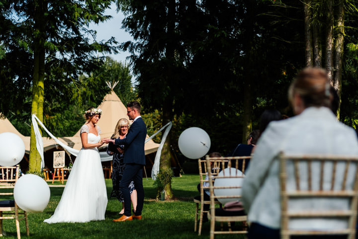 'Secret Garden' Festival Tipi Wedding in Northamptonshire by Aaron Collett Photography, with flower crowns and an outdoor ceremony.