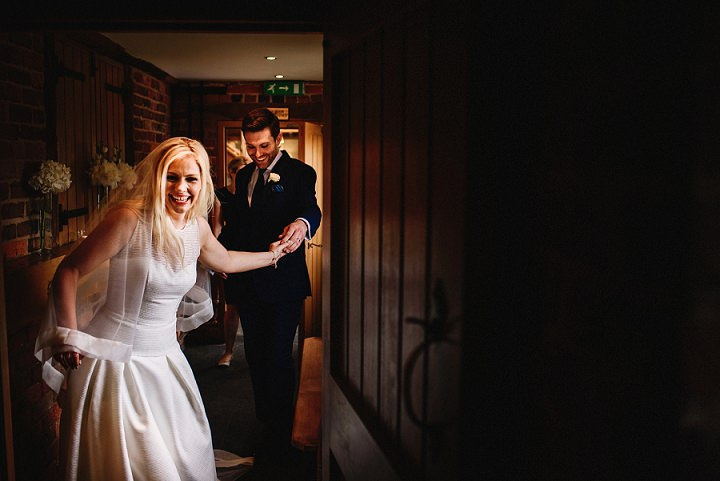 Elegant Whimsy Flower Filled White and Rose Gold Wedding by Andy Gaines