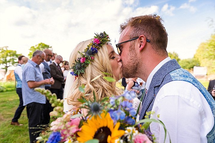 Kathryn and Andrew's Colourful Ribbon Filled Festival Vibe Glamping Wedding in Norfolk by Andy Kahumbu